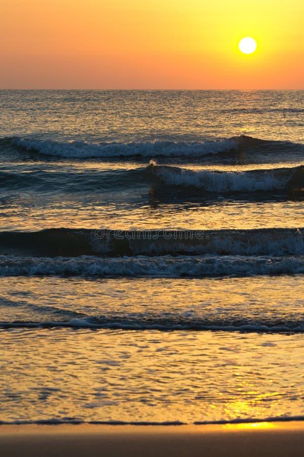 Download Sunrise stock image. Image of ocean, flow, orange, sandy - 26595161