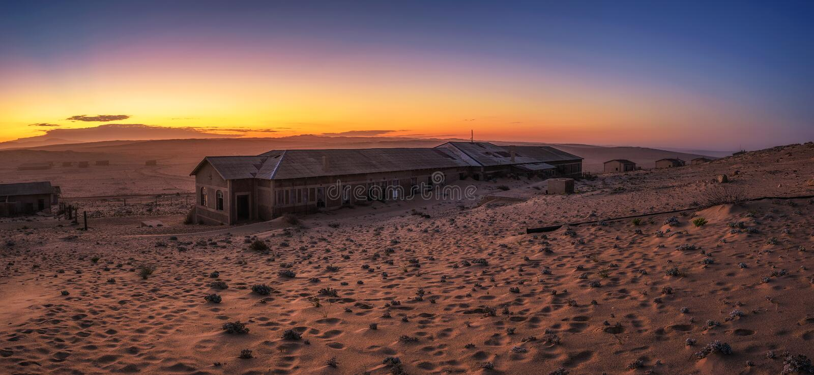 Sunrise above the abandoned houses of Kolmanskop ghost town, Namibia. royalty free stock images