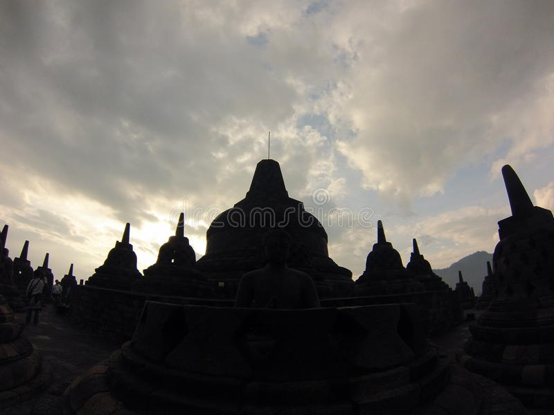 Sunrise above Borubadur temple. Very early morning followed by slightly cloudy start to the day. Sunrise after all royalty free stock images