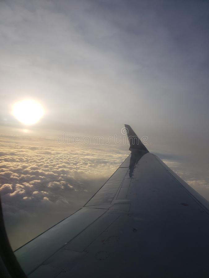 Sunrise above the clouds stock image