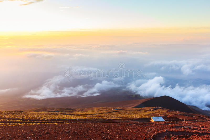 Sunrise above clouds and warm sky. stock images