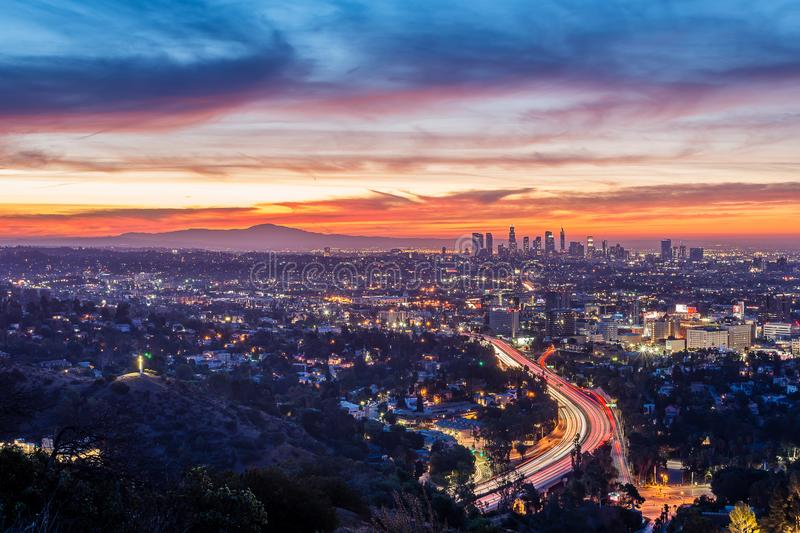 Sunrise from above the Hollywood Bowl. Dawn begins to shine light over Los Angeles and the rest of Southern California stock photo