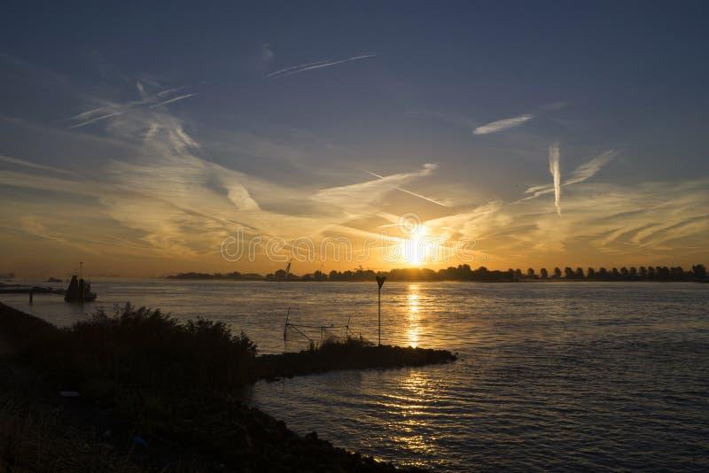 Sunrise above the river Merwede. Near the village Boven-Hardinxveld in the Dutch region Alblasserwaard royalty free stock image