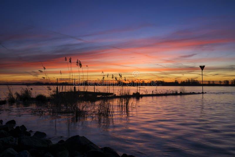 Sunrise above the river Merwede. Spectacular sunrise above the river Merwede near Boven-Hardinxveld in the dutch region Alblasserwaard stock image