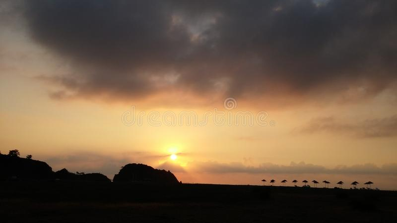 Sunrise above the sea silhouette of mountains. Cirali Beach Turkey summer time royalty free stock photography
