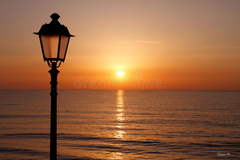 Sunrise on the Adriatic sea. In Roman times it was home to a major port, named after the emperor Hadrian, who had ordered the reconstruction (source: Pausanias royalty free stock photo