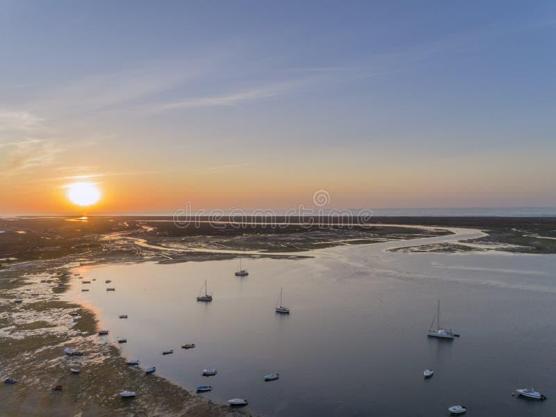 Sunrise aerial seascape, in Ria Formosa wetlands natural park, Algarve. stock photos