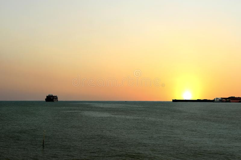 Sunrise appears on the high seas that look so beautiful. With the bright sunlight so bright the activities of the fishermen are full of enthusiasm, in the royalty free stock photos