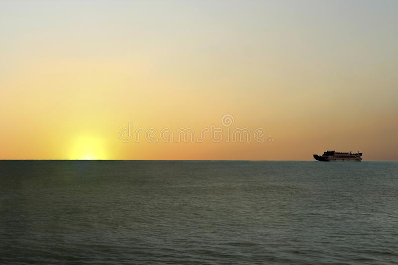 Sunrise appears on the high seas that look so beautiful. With the bright sunlight so bright the activities of the fishermen are full of enthusiasm, in the stock photo