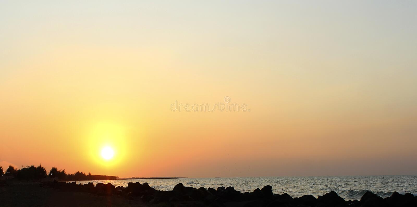 Sunrise appears on the high seas that look so beautiful. With the bright sunlight so bright the activities of the fishermen are full of enthusiasm, in the royalty free stock image
