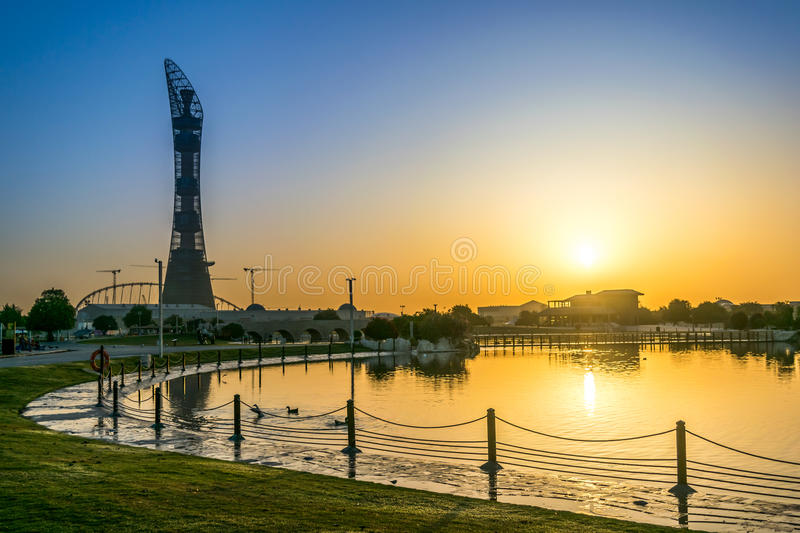 Sunrise from Aspire Park. Shot taken from Aspire Park, Doha, Qatar, March 2 2015 . The Building is Aspire Tower, also known as The Torch Doha stock photography