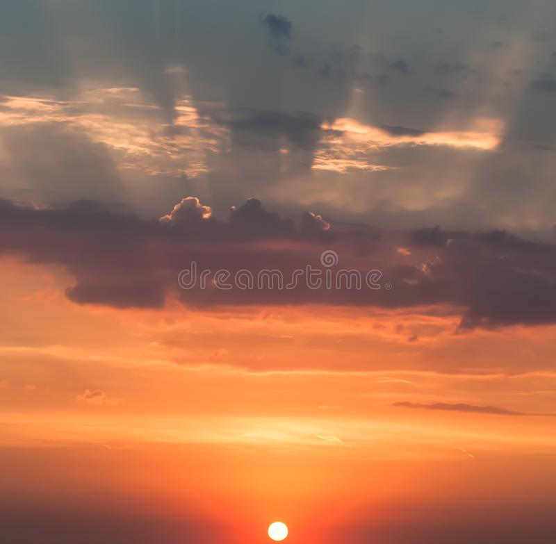 Sunrise in autumn, the rising sun over the horizon, the rays piercing the clouds and the sky. stock photo
