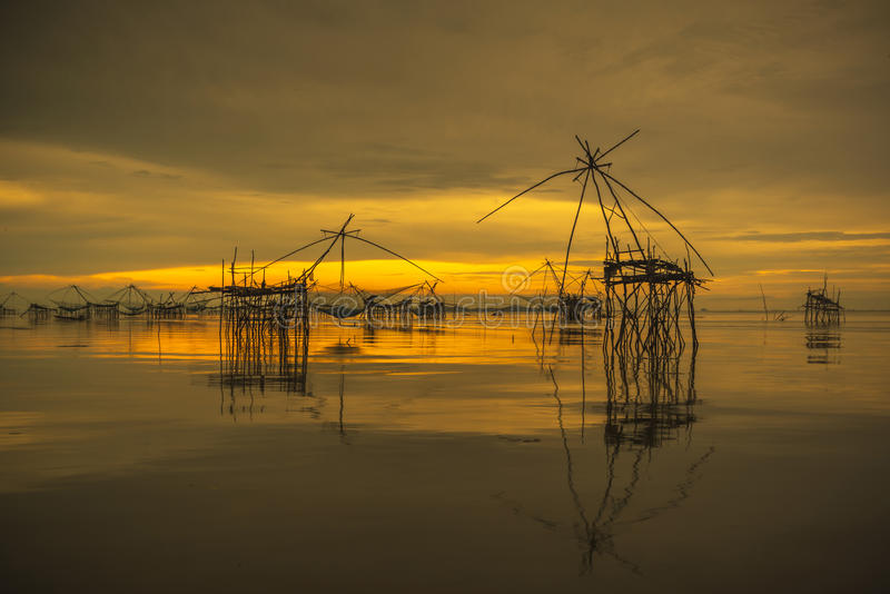 Sunrise background with fishing equipment. Landscape sunrise time on lake in southern part of Thailand royalty free stock images
