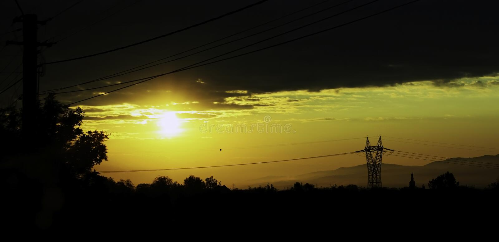 Sunrise pylon royalty free stock photography