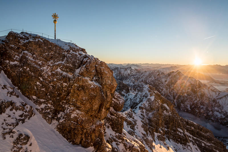 Sunrise at the Zugspitze. At Germanys highest mountain, the Zugspitze, in a frosty winter morning. The top is 2966 meters about sea-level stock photography