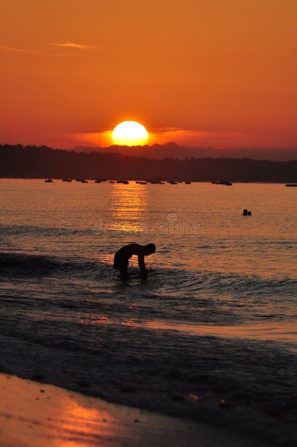 Sunrise on beach stock photography