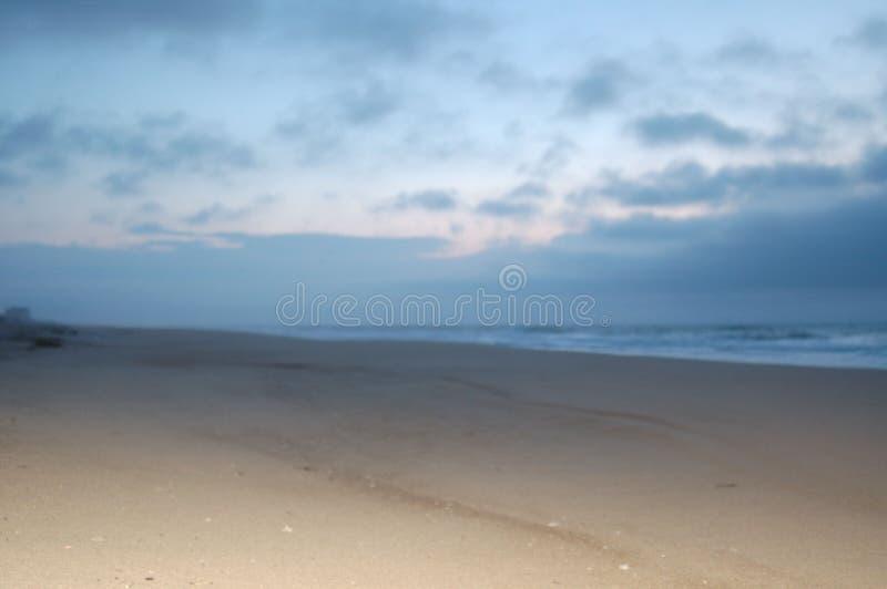 Sunrise on the beach in april stock photos