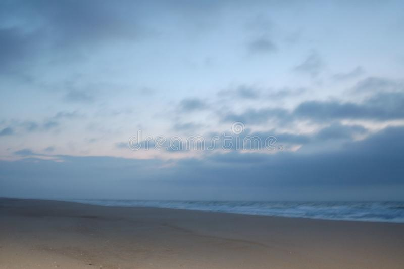 Sunrise on the beach in april royalty free stock image