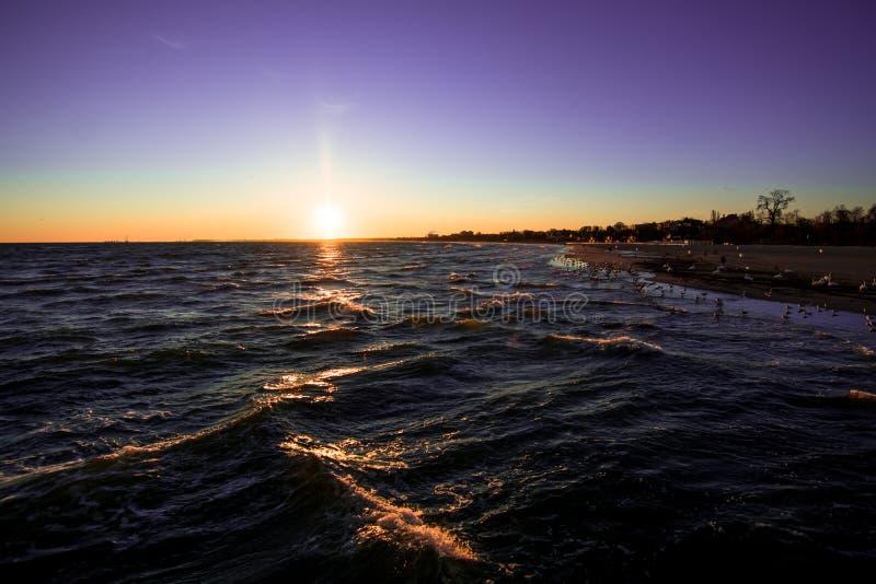 Sunrise on the beach of the Baltic sea, Sopot, Poland stock photos