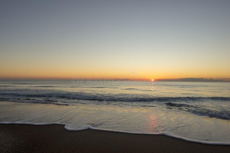Sunrise on a beach in Denia, Alicante stock photos