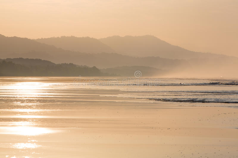 Sunrise on the beach of Matapalo in Costa Rica royalty free stock photography