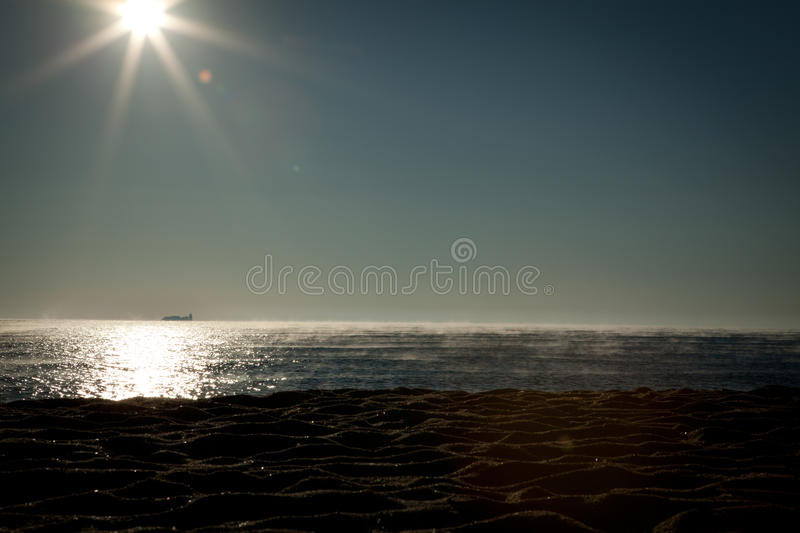 Sunrise beach mist royalty free stock images