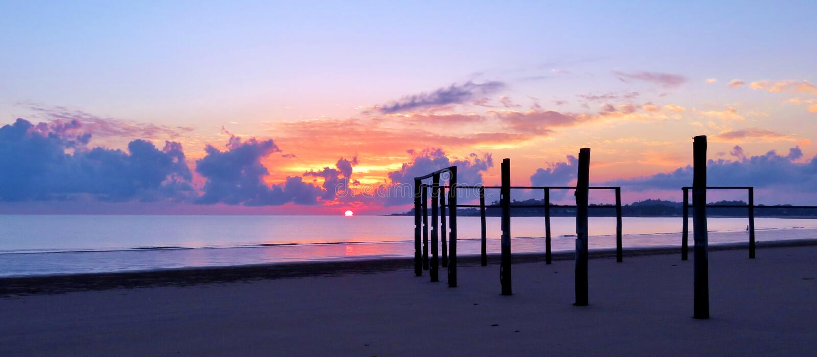 Sunrise at the beach. Sunrise over the water at Bucasia Beach stock photos