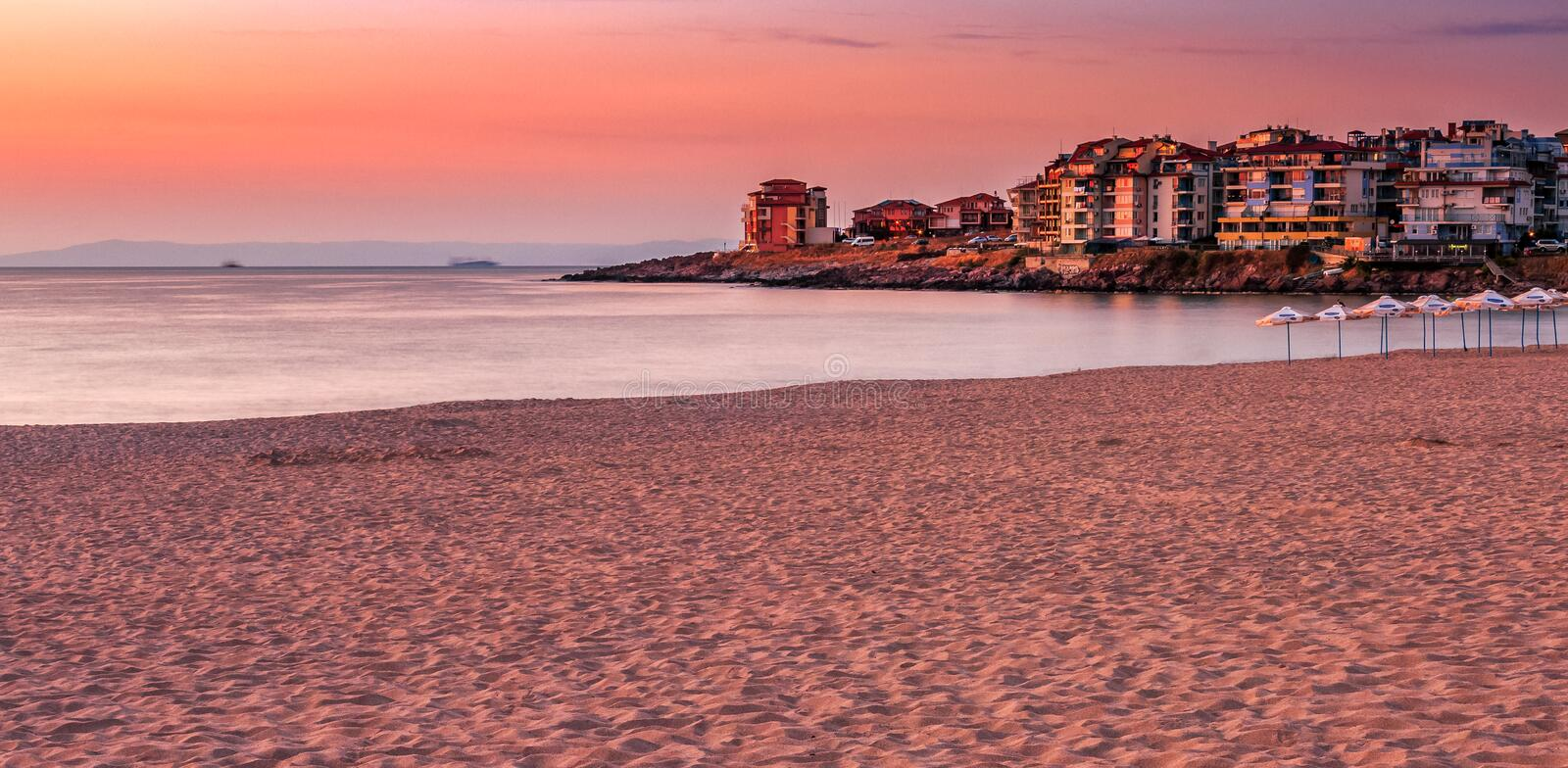 Sunrise at the beach of Sozopol. SOZOPOL, BULGARIA - SEPTEMBER 11, 2013: sunrise on sandy city beach in mellow season. Beautiful and warm weather on the shores royalty free stock photos