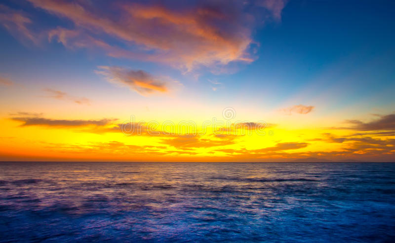 Sunrise over the blue water sea stock images