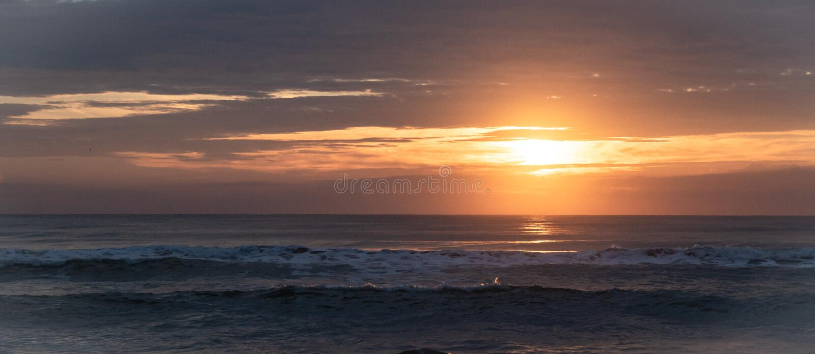 Sunrise and beautiful reflection over the sea in the morning holiday at Ban Krut Beach, Prachuapkirikhan, South of Thailand. stock photography