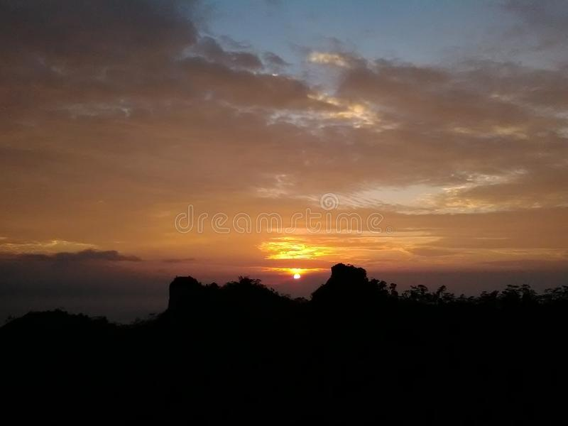 Sunrise. Beautiful sky when sun show his head saying hello to the world royalty free stock photography