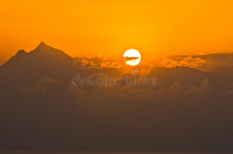 Sunrise behind clouds at holy mountain Athos stock image