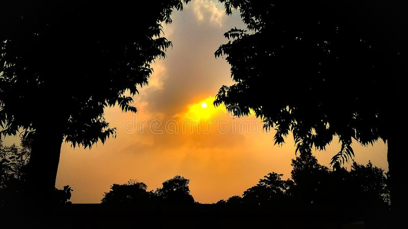 Sunrise behind the clouds royalty free stock photos