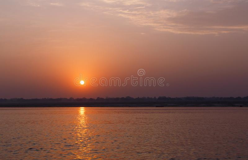 Sunrise behind Ganga river in Varanasi. India royalty free stock photos