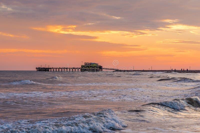 Galveston Island, Texas. Sunrise behind the Historic Pleasure Pier on Galveston Island, Texas in the Gulf of Mexico stock photo
