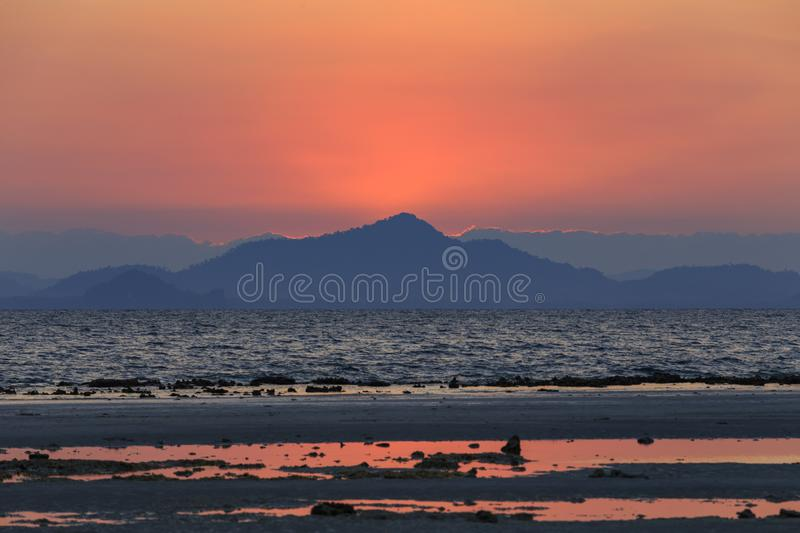 Sunrise behind the island at Koh Ngai island on the southern andaman coast. Trang province, Thailand royalty free stock photos