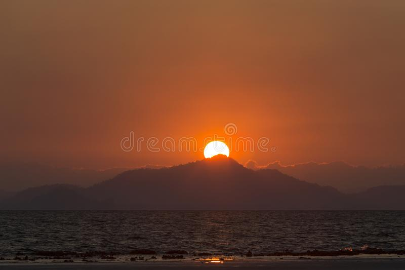 Sunrise behind the island at Koh Ngai island on the southern andaman coast. Trang province, Thailand royalty free stock photo