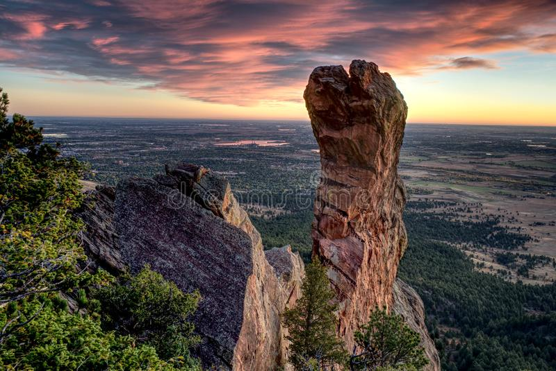 Sunrise behind the Maiden. Boulder, CO royalty free stock photos