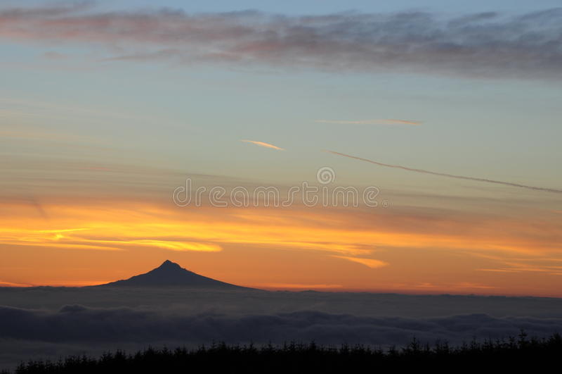 Sunrise behind Mount Hood stock image