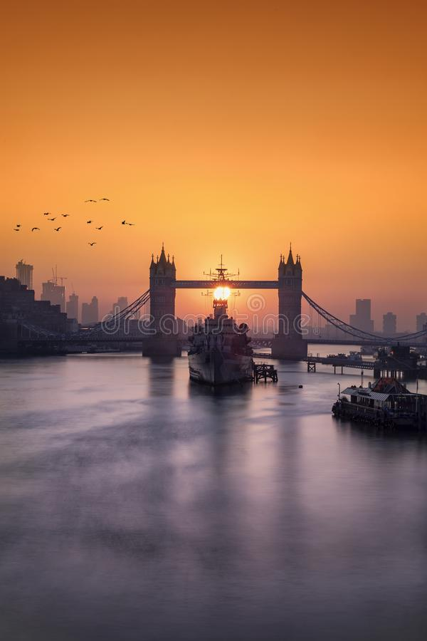 Sunrise behind the Tower Bridge in London, United Kingdom. Idyllic sunrise behind the Tower Bridge, a major landmark in London, United Kingdom stock photography
