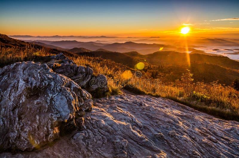 Sunrise, Black Balsam Blad, blue Ridge Parkway. A beautiful autumn sunrise from atop of Black Balsam Knob along the Blue Ridge Parkway in North Carolina. Warm royalty free stock photography