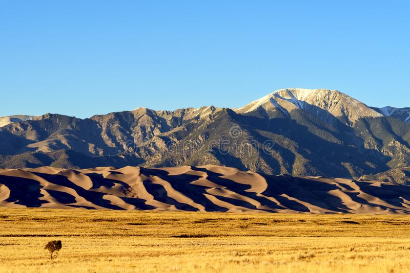 Sunrise with Blue Skies at Great Sand Dunes National Park Colorado, USA royalty free stock photo