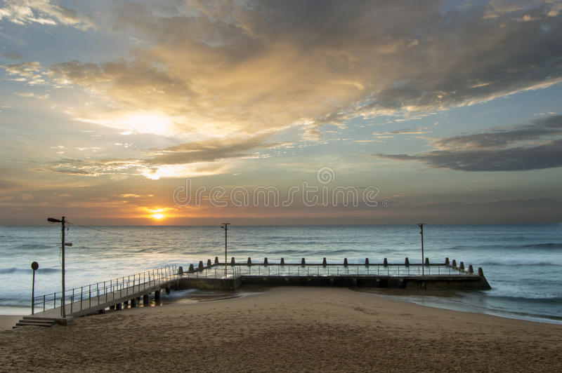 Sunrise on the bluff. This image was shot In sunny Durban, South Africa. What started off as a very pink morning resulted in this beautiful scenery stock photo