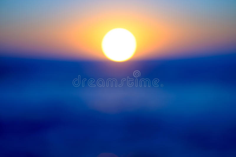 Sunrise blur. Blur of sunrise over water stock photography