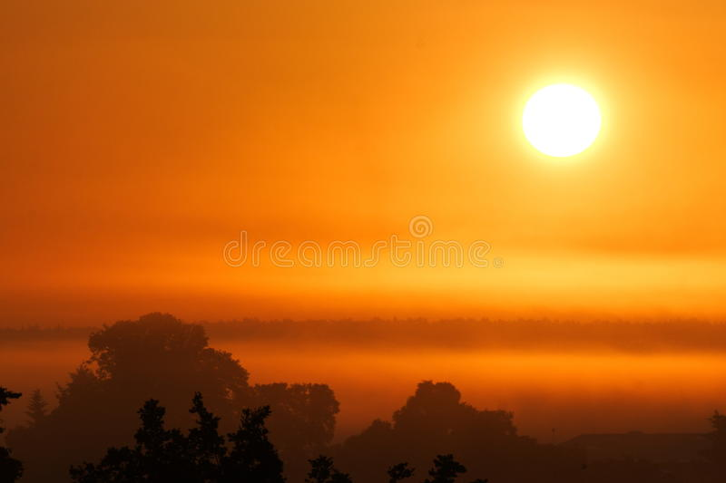 Sunrise in Bohemia. Sunrise with a strong haze in eastern Bohemia royalty free stock photo