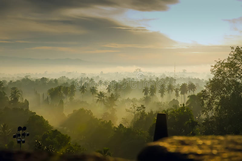 Sunrise in Borobudur. Indonesia, wint jungle and mist royalty free stock photography