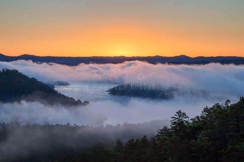 Sunrise at Broken Bow Lake. The sun rises on a foggy morning at Broken Bow Lake in Oklahoma, USA stock images