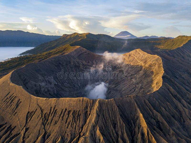 Sunrise at Bromo Tengger Semeru National Park in East Java, Indonesia. Taken with a drone. Low clouds visible around Mount Bromo crater royalty free stock photos
