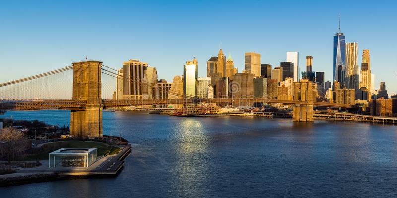 Sunrise on the Brooklyn Bridge and the skyscrapers of Lower Manhattan. New York City stock photo
