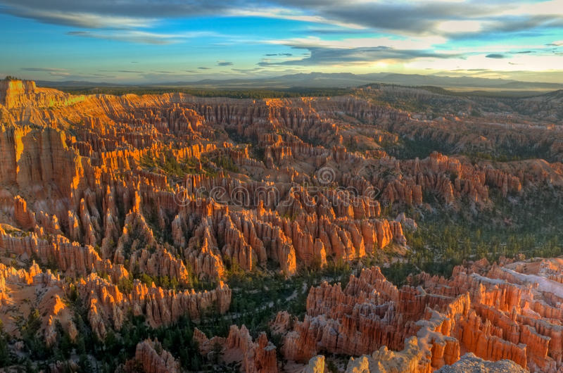 Download Sunrise on Bryce Canyon stock photo. Image of blue, forest - 14326406